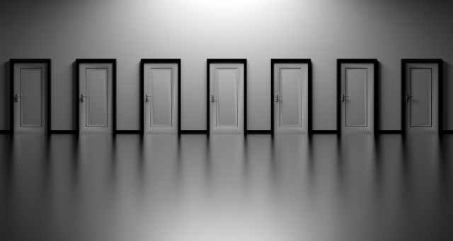 black and white decision doors opportunity